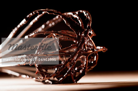 An egg whisk with remnants of cake batter Stock Photo - Premium Royalty-Free, Image code: 659-06903995