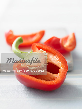 A red pepper, sliced open Stock Photo - Premium Royalty-Free, Image code: 659-07026912