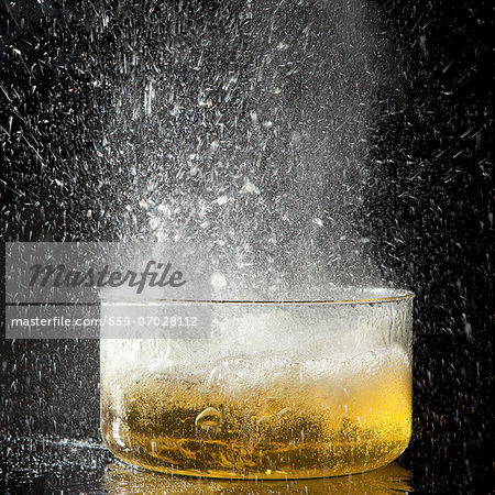 An explosion of oil caused by adding an ice cube Stock Photo - Premium Royalty-Free, Image code: 659-07028112