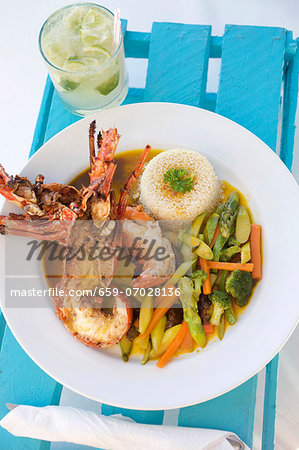 Halved Lobster with Couscous and Vegetables; In a White Bowl Stock Photo - Premium Royalty-Free, Image code: 659-07028136