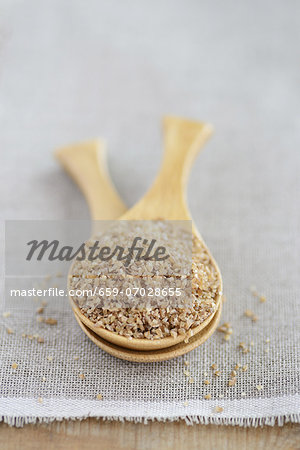 Bulgur (coarse-ground wheat) in a wooden spoon Stock Photo - Premium Royalty-Free, Image code: 659-07028655