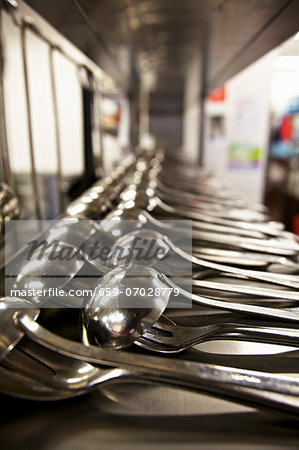 Lots of ladles in the kitchen of a restaurant Stock Photo - Premium Royalty-Free, Image code: 659-07028779