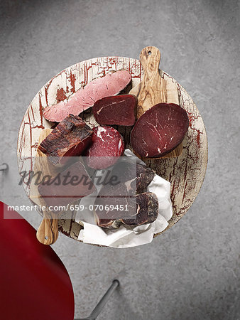 Assorted chunks of smoked ham (view from above) Stock Photo - Premium Royalty-Free, Image code: 659-07069451