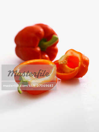Red peppers, whole and halved Stock Photo - Premium Royalty-Free, Image code: 659-07069683