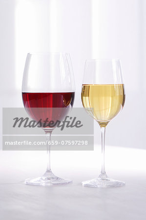 Glass of red wine and glass of white wine Stock Photo - Premium Royalty-Free, Image code: 659-07597298