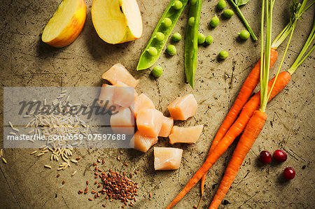 Chunks of Raw Chicken with Assorted Ingredients Stock Photo - Premium Royalty-Free, Image code: 659-07597688