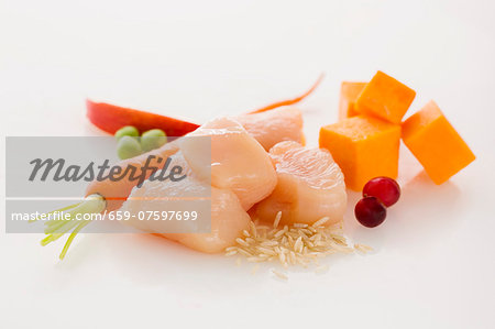 Raw Cubes of Chicken with Assorted Ingredients Stock Photo - Premium Royalty-Free, Image code: 659-07597699