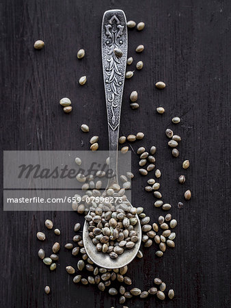 Cannabis grains on a teaspoon. Stock Photo - Premium Royalty-Free, Image code: 659-07598273