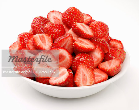Whole and halved strawberries in a bowl Stock Photo - Premium Royalty-Free, Image code: 659-07598387