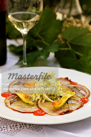 Carpaccio of suckling pig with spicy sweet and sour cabbage