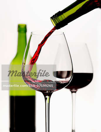 Red wine being poured into a glass Stock Photo - Premium Royalty-Free, Image code: 659-07599265