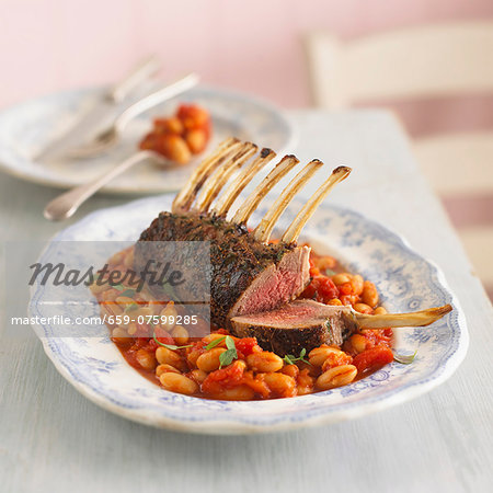 Rack of lamb on a bean and tomato medley Stock Photo - Premium Royalty-Free, Image code: 659-07599285