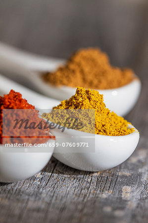 Three spoons of different spices (close-up) Stock Photo - Premium Royalty-Free, Image code: 659-07609771