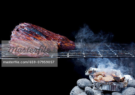 Whole Rack of Pork Ribs on Grill with Barbecue Sauce Stock Photo - Premium Royalty-Free, Image code: 659-07959057