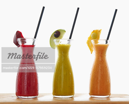 Three different smoothies in carafes Stock Photo - Premium Royalty-Free, Image code: 659-07959234