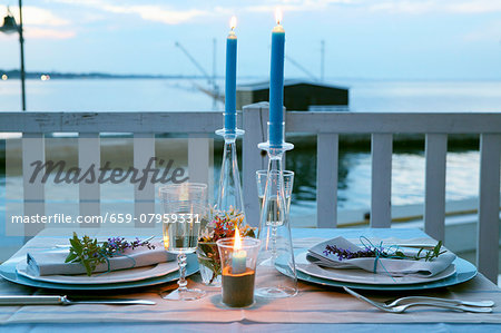 A table laid outside at dusk Stock Photo - Premium Royalty-Free, Image code: 659-07959331