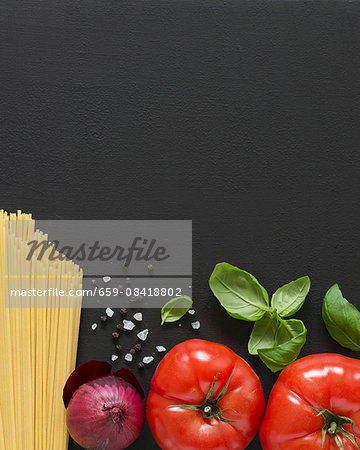 Ingredients for spaghetti with tomato sauce Stock Photo - Premium Royalty-Free, Image code: 659-08418802