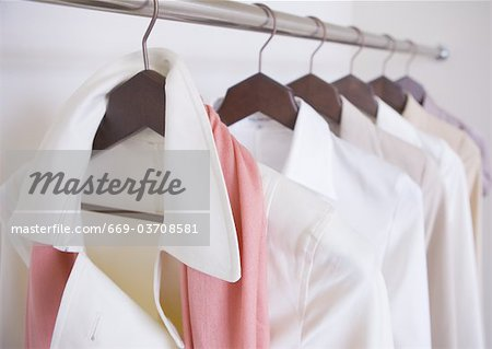 Clothes on hangers Stock Photo - Premium Royalty-Free, Image code: 669-03708581