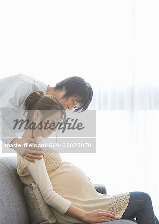 Man taking care of his pregnant wife Stock Photo - Premium Royalty-Free, Image code: 669-06023070