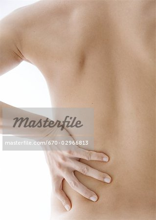 A man touching his back Stock Photo - Premium Royalty-Free, Image code: 670-02966813