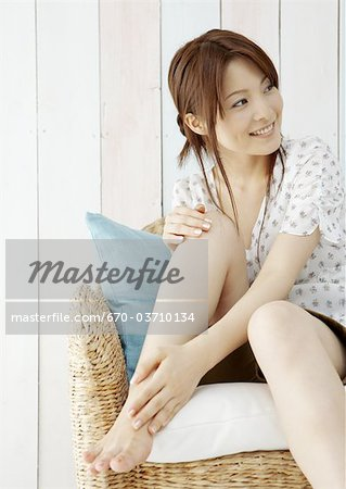 Young woman caring for her legs Stock Photo - Premium Royalty-Free, Image code: 670-03710134