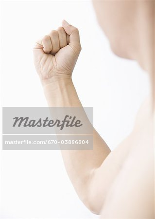Man clenching fist Stock Photo - Premium Royalty-Free, Image code: 670-03886804