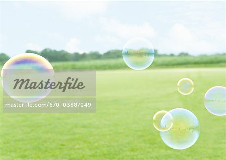 Grass field and bubbles Stock Photo - Premium Royalty-Free, Image code: 670-03887049