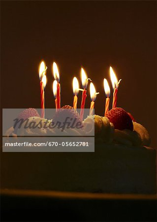Strawberry birthday cake with lit candles Stock Photo - Premium Royalty-Free, Image code: 670-05652781