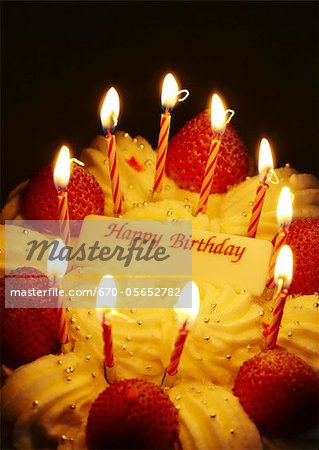 Strawberry birthday cake with lit candles Stock Photo - Premium Royalty-Free, Image code: 670-05652782