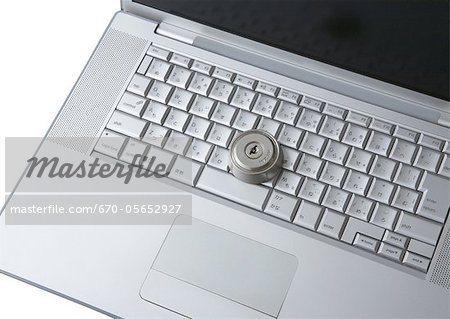 Computer keyboards with keyhole Stock Photo - Premium Royalty-Free, Image code: 670-05652927