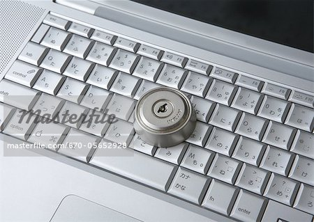Computer keyboards with keyhole Stock Photo - Premium Royalty-Free, Image code: 670-05652928