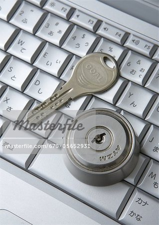 Computer keyboards with keyhole and key Stock Photo - Premium Royalty-Free, Image code: 670-05652931
