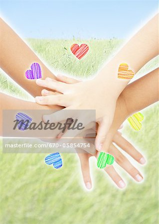 Stacked hands and circle of hearts
