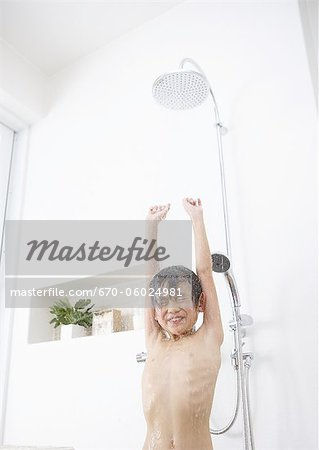 Boy taking a shower Stock Photo - Premium Royalty-Free, Image code: 670-06024981