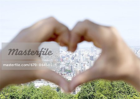 Cityscape in hands making a heart shape Stock Photo - Premium Royalty-Free, Image code: 670-06450016