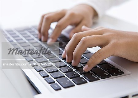 Hands typing on a laptop Stock Photo - Premium Royalty-Free, Image code: 670-06451292