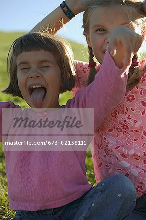 Two young girls making faces. Stock Photo - Premium Royalty-Free, Image code: 673-02138111