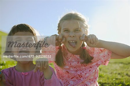Two young girls making faces. Stock Photo - Premium Royalty-Free, Image code: 673-02138112