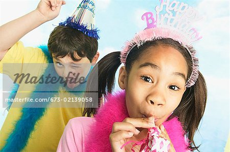 Boy and girl in party hats Stock Photo - Premium Royalty-Free, Image code: 673-02139058