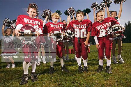 Boys football team and cheerleaders Stock Photo - Premium Royalty-Free, Image code: 673-02139178