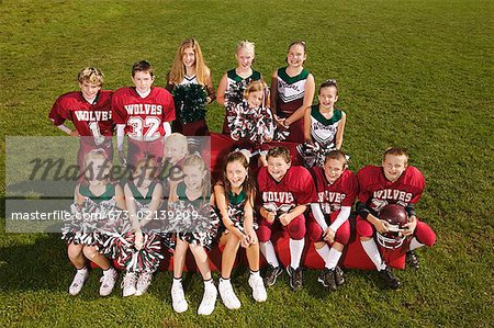 Young football players and cheerleaders Stock Photo - Premium Royalty-Free, Image code: 673-02139209
