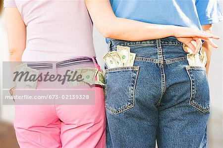 Woman taking money from man's pocket Stock Photo - Premium Royalty-Free, Image code: 673-02139328