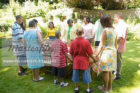 Family holding hands at picnic Stock Photo - Premium Royalty-Free, Image code: 673-02139605