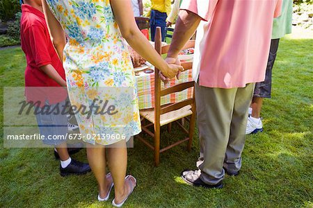 Family holding hands at picnic Stock Photo - Premium Royalty-Free, Image code: 673-02139606
