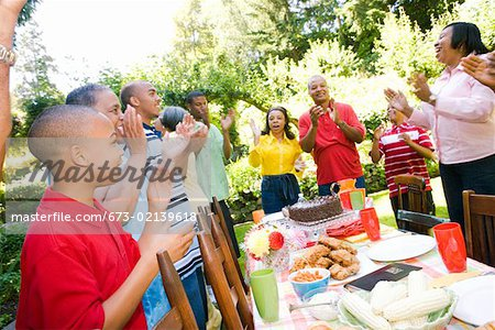 Enthusiastic family at picnic Stock Photo - Premium Royalty-Free, Image code: 673-02139618