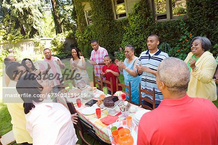 Enthusiastic family at picnic Stock Photo - Premium Royalty-Free, Image code: 673-02139619