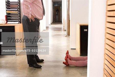 Office worker discovering prone female body Stock Photo - Premium Royalty-Free, Image code: 673-02139634