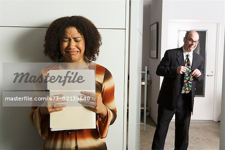 Geeky man pursuing female co- worker Stock Photo - Premium Royalty-Free, Image code: 673-02139640