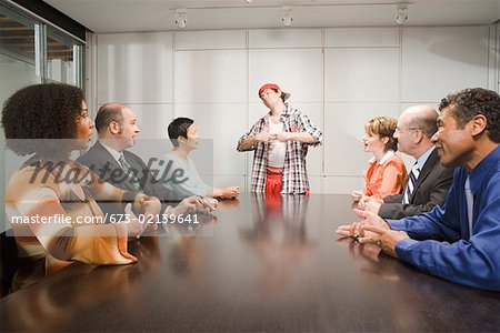 Weird co-worker at a meeting Stock Photo - Premium Royalty-Free, Image code: 673-02139641
