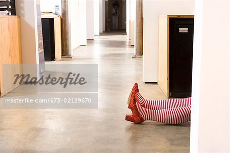 Body lying on office floor Stock Photo - Premium Royalty-Free, Image code: 673-02139670